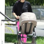 Jessica Hart in a Black Tee Walks with Her Baby in Los Angeles 07/20/2021