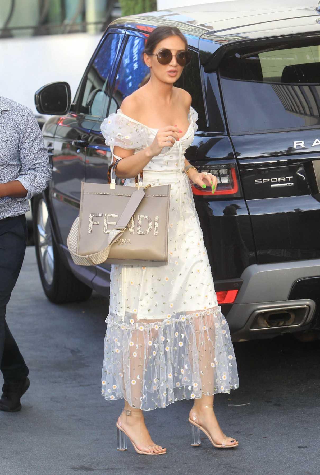 Megan Pormer in a White Floral Dress