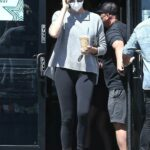Charlize Theron in a Grey Sweater Makes a Quick Stop at Her Local Starbucks in West Hollywood 08/27/2021