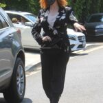 Christina Hendricks in a Black Floral Blouse Attends the Day of Indulgence Party in Brentwood 08/15/2021