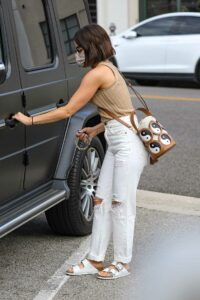 Lucy Hale in a White Ripped Jeans