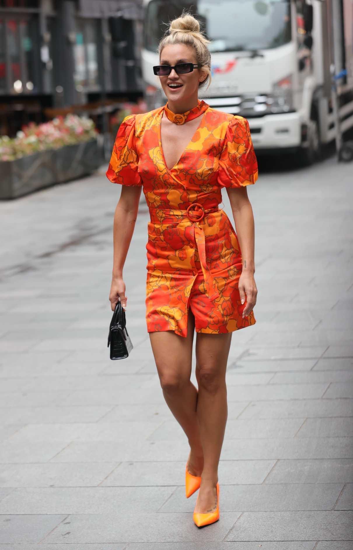 Ashley Roberts in an Orange Floral Dress