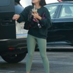 Lucy Hale in an Olive Leggings Arrives at the Gym with a Friend in Los Angeles 09/25/2021