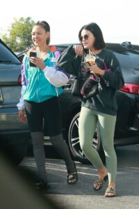 Lucy Hale in an Olive Leggings