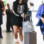 Vanessa Hudgens in a Black Skeleton Print Hoodie Arrives at JFK Airport in New York 09/27/2021