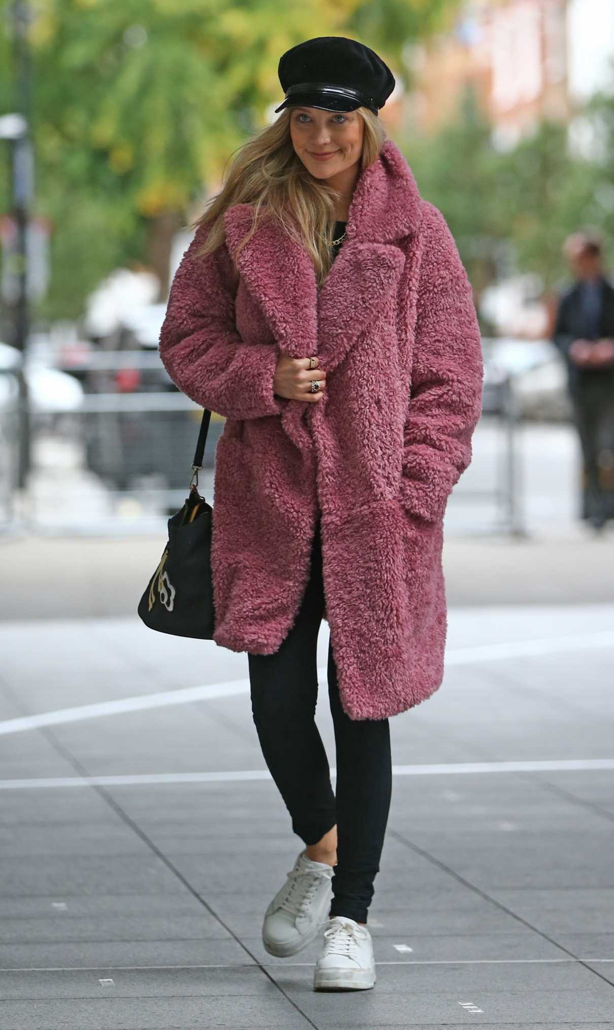 Laura Whitmore in a Pink Faux Fur Coat